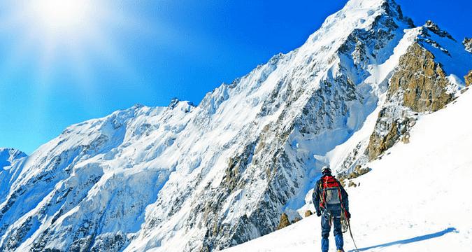 mountain climbing in snow